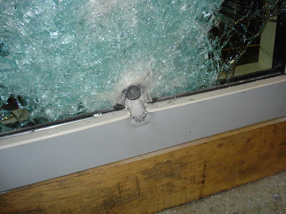bullet resistant glass testing image showing bullet proof glazing and steel framework
