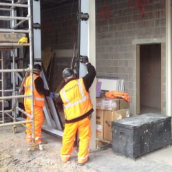 technical support Installations men installing steel framework