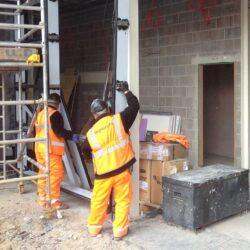 technical support Installations men installing steel framework