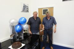 Denis Wright, chairman, with Tim Kempster, managing director - about to cut the birthday cake