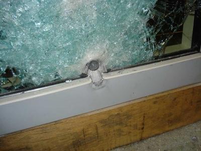 bullet resistant glass testing image showing bullet proof glazing and steel framework